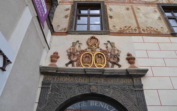 RICHLY DECORATED PORTAL WITH COAT OF ARMS
